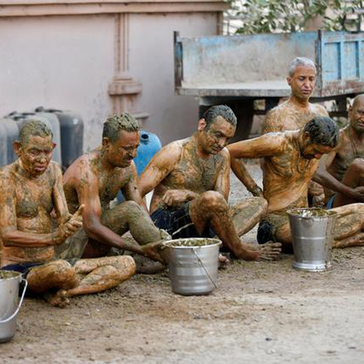 Indians putting cow dung