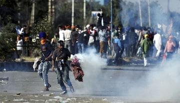 कृषि कानूनों के खिलाफ प्रदर्शन कर रहे किसान (फोटो-PTI)