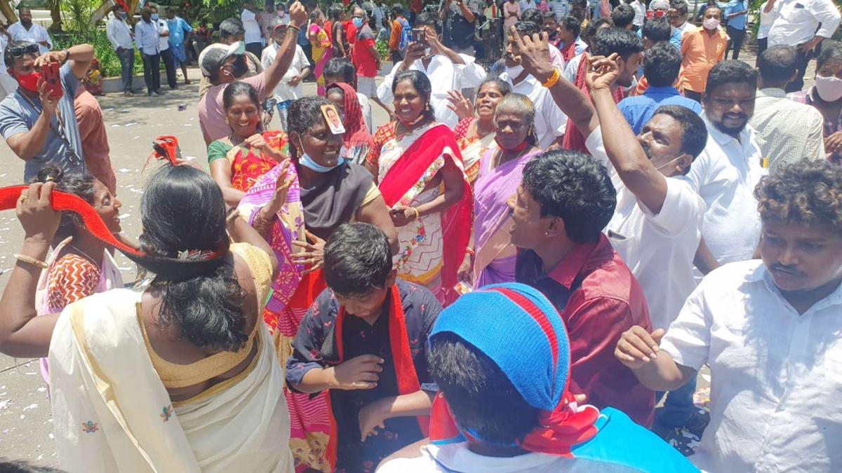 DMK supporters celebrate outside Anna Arivalayam