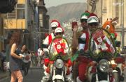 Santas watchout for traffic on streets of Lima