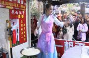 Chinese cooks dance the noodle-boogie in the kitchen