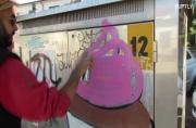 Italian street artist covers up swastika graffiti with giant cupcakes