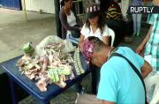 Venezuelan Craftsman Makes Handbags Out of Worthless Banknotes
