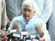 Is Salman Khurshid threatening Arvind Kejriwal?