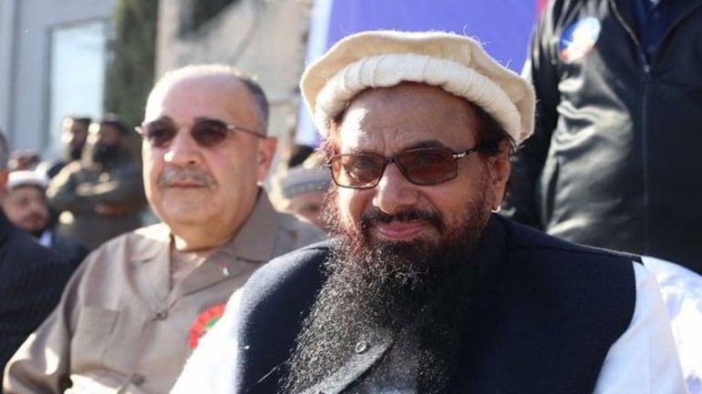 Walid Abu Ali with Hafiz Saeed (Photo: Twitter/@TarekFatah)