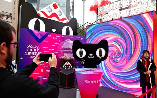 A mascot for Tmall, an online shopping website owned by Alibaba, promoting Singles Day in Beijing on Monday. (Photo: AP)