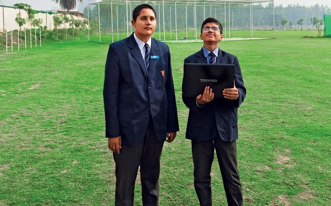 Vedant (left) and schoolmate Satvik with the CanSat at the school campus. Photo: Sandeep Sahdev