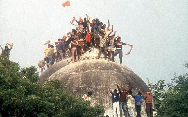 Kar sevaks atop the Babri Masjid on December 6, 1992