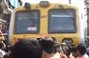 Local party stops train at Chembur station. Photo courtesy: Screengrab from YouTube video (@entertainhub)