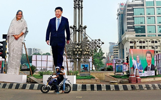 Cutouts of Xi Jinping and Sheikh Hasina during the Chinese leader's Dhaka visit in 2016. Source: AP