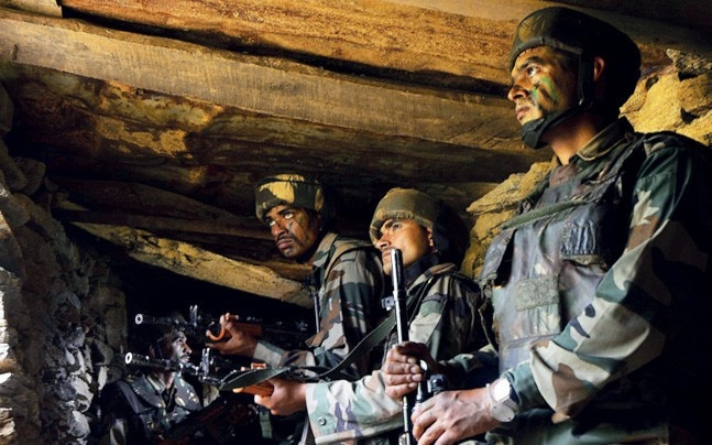 ARMS CRUNCH The army fears it won't have the money to pay for the replacements of obsolete INSAS rifles and light machine guns of the kind carried by these soldiers along the LoC. Photo: Chandradeep Kumar