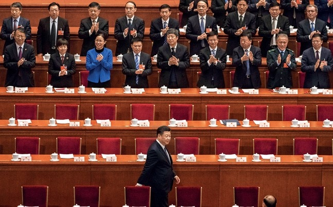CHAIRMAN FOR LIFE Xi Jinping at the National People's Congress on March 20. Photo: KEVIN FRAYER/GETTY IMAGES