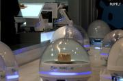 Robot waiters deliver orders at Alibaba's seafood restaurant