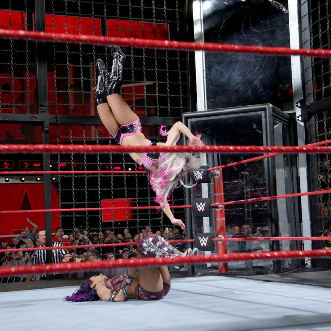 Alexa Bliss performing the Twisted Bliss on Sasha Banks at WWE Elimination Chamber