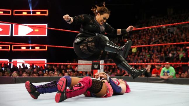 Ronda Rousey throws Triple H through table!