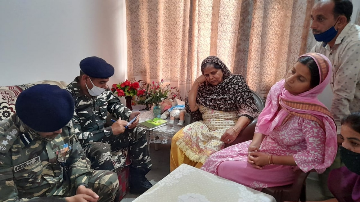 CRPF officials meet the family of Constable Rakeshwar Singh Manhas.