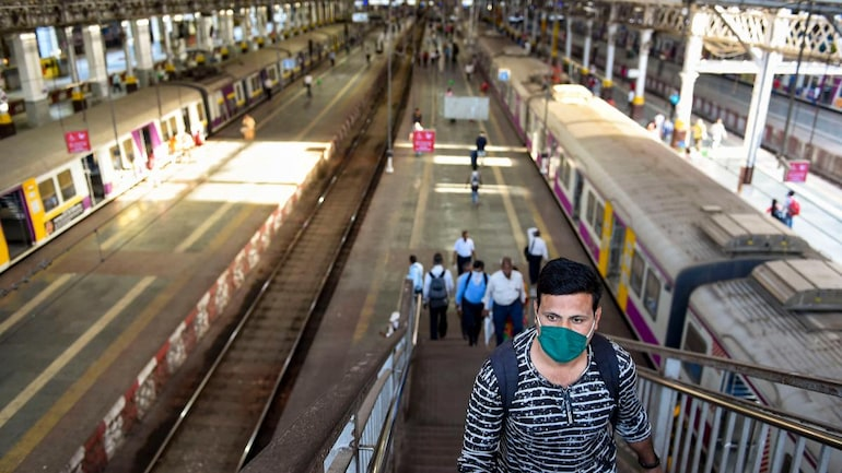 Passengers with protective masks at Mumbai's CST railway station on Friday