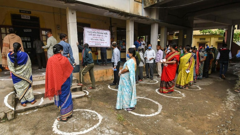 Voters queuing up to cast their votes at a polling station in Assam's Nagaon district on Thursday