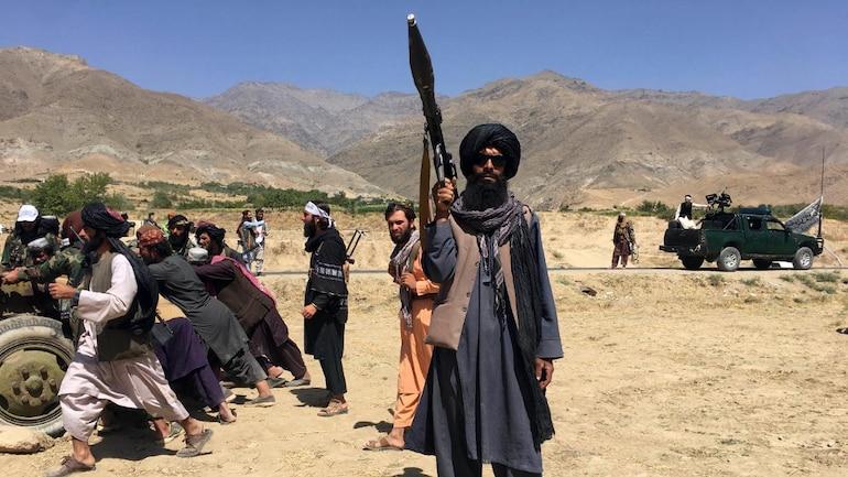 Taliban fighter holds a gun