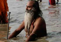 Devotees take a holy dip at Ganga Sagar