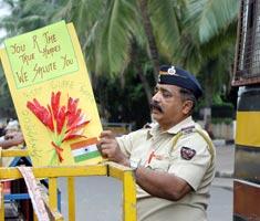 A shaken Mumbai fights back