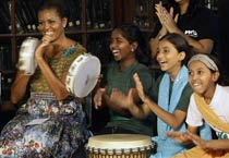 Michelle plays, dances with kids