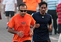 Anil Ambani jogging wearing a T-shirt written instant relief