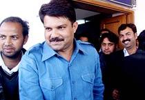 Absconding Raj minister surrenders before court