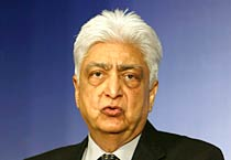 Azim Premji addressing a press conference