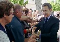 French President Nicolas Sarkozy manhandled
