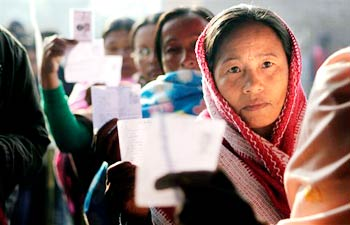 Women voters show their election cards in Manipur