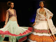 A model walks the ramp in a Manish Malhotra outfit.