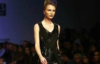 A model walks the ramp in a Gaurav Gupta dress
