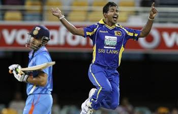 Sri Lanka paceman Nuwan Kulasekara and India's Gautam Ghambir