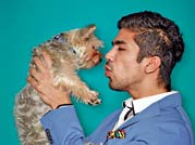 Saquib Saleem and Oliver, a Yorkshire Terrier.