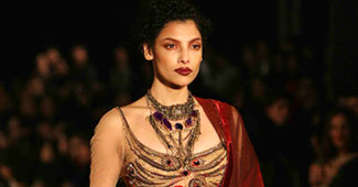 A model walks the ramp in a Tarun Tahiliani outfit.
