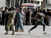 A series of explosions followed by sustained gunfire shook the Afghan capital on Sunday, April 15, 2012.