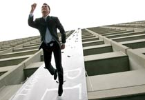 A model rappels down a 24-story high building.