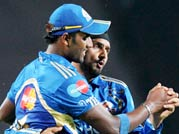 Mumbai Indians Harbhajan Singh and a team-mate