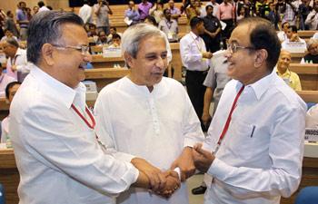 Raman Singh (Left), Naveen Patnaik (centre) and P Chidamabaram (right)