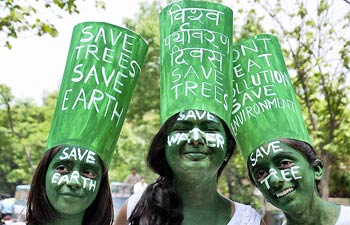 Activists spread awareness about environmental conservation by painting their faces and wearing special hats on the occasion of World Environment Day 2012 on Tuesday, June 05, 2012.