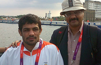 Silver medallist Sushil Kumar with Mail Today sports editor S. Kannan