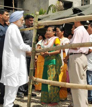 prime minister manmohan singh, assam, riot-hit districts in assam, relief package, riot-hit survivors