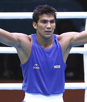Indian boxer Manoj Kumar celebrates after winning his first bout