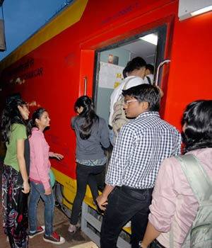 Passengers boarding the AC double-decker train running between Delhi and Jaipur.