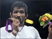 Wrestler Yogeshwar Dutt celebrates his win