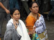 Mamata Banerjee (centre) with Trinamool Congress workers at a protest rally in Kolkata.