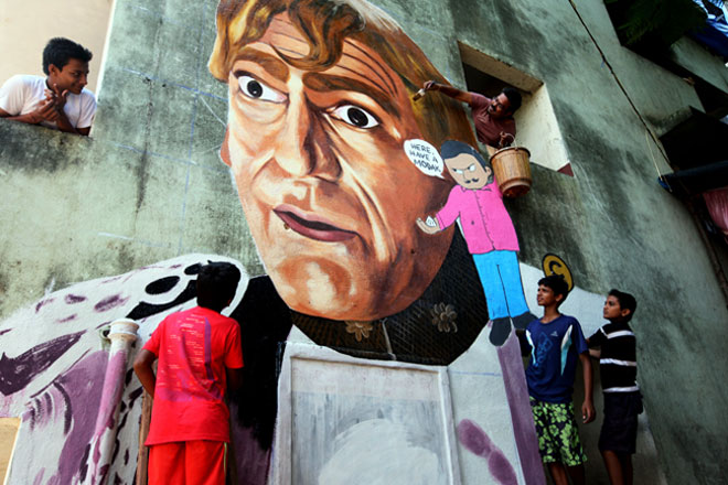 Artist working on Amrish Puri graffiti