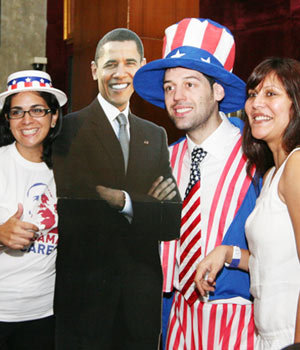 People celebrate Barack Obama's victory at the US consulate in Mumbai