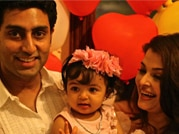 Daddy's girl Aaradhya's first b'day pics